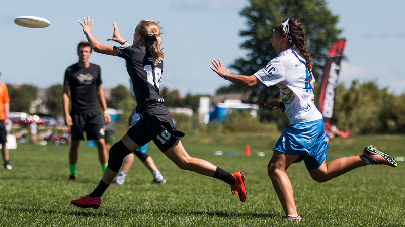 Swing Vote's Ella Juengt catches a goal out in front of a Bay Area defender in the YCC Mixed final. Photo: Daniel Thai -- UltiPhotos.com